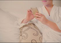 a person using morning routin apps in bed